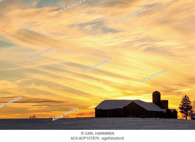 Sunset over farm, Huron County, near Goderich, Ontario, Canada