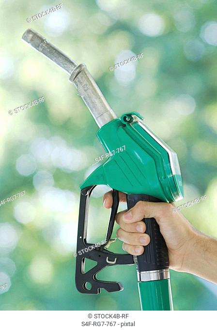 Hand holding fuel nozzle