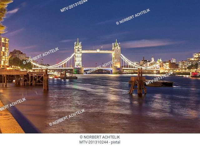 Tower Bridge and London city at night, England