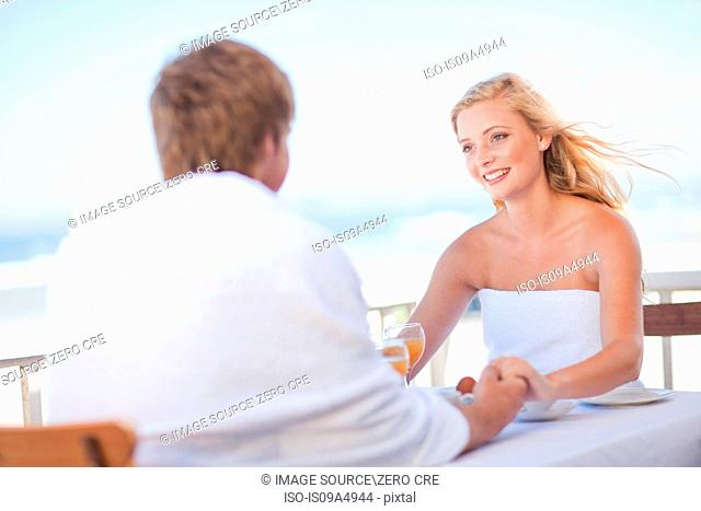 Couple having breakfast outdoors