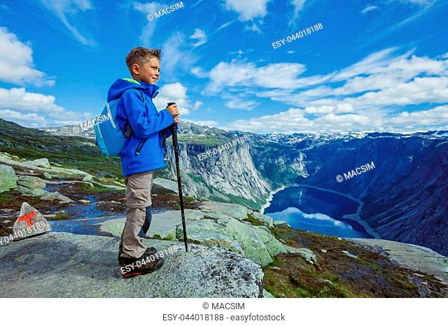Best Norway hike. Cute boy with hiking equipment in the mountains