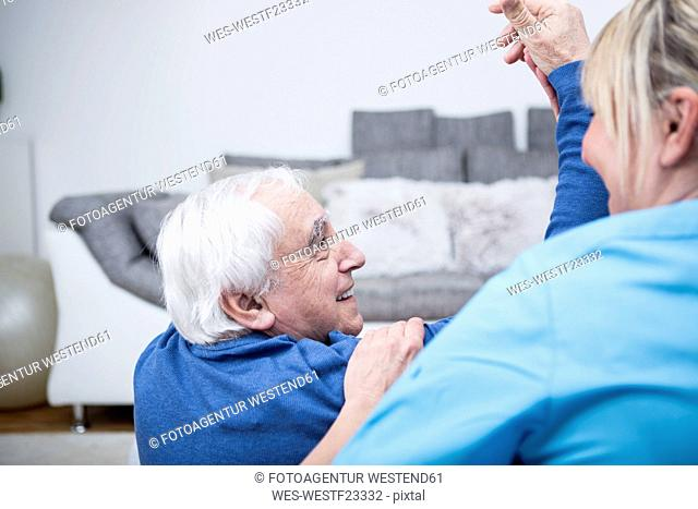Gereatric nurse doing physio therapy with patient