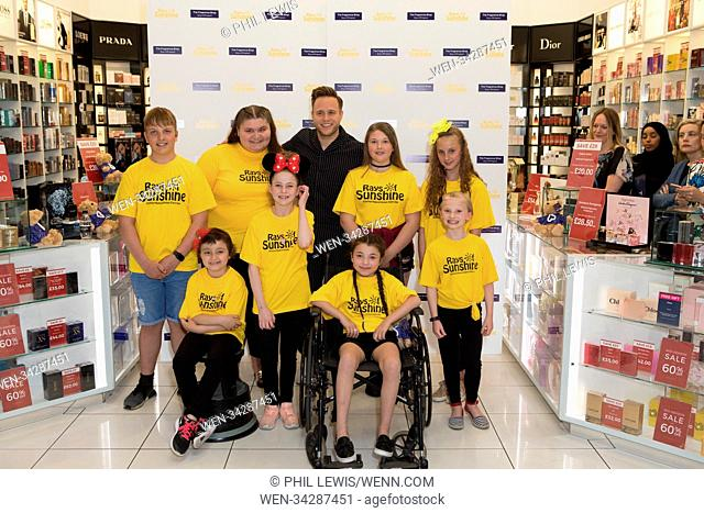 Olly Murs receiving cheque on behalf of Rays Of Sunshine and with the children's charity choir Featuring: Olly Murs, Rays Of Sunshine Childrens charity choir...