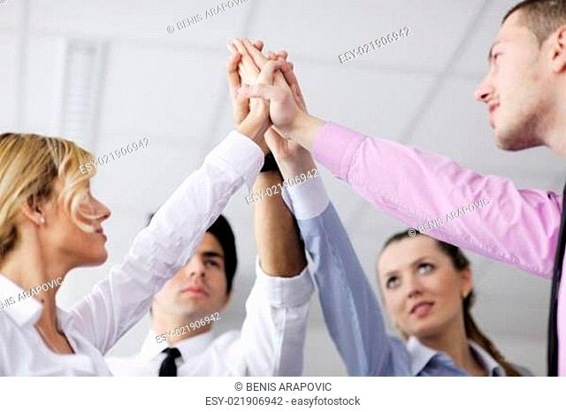 business people group joining hands