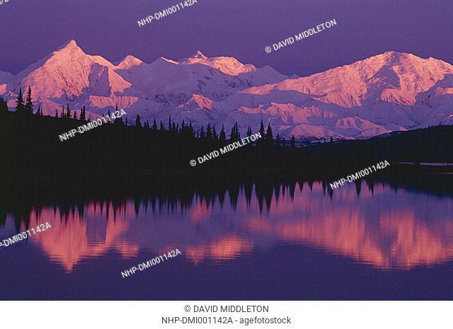 ALASKA RANGE in afterglow reflected in Wonder Lake Denali Nat- ional Park, south central Alaska, USA