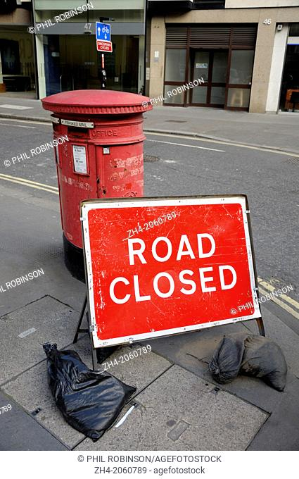 London, England, UK. Red letter box and Road Closed sign in the City