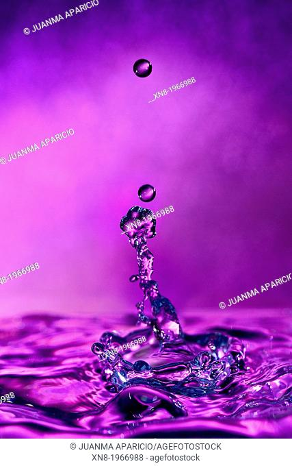 High-speed photograph of a water drop impacting on water showing secondary drops formation