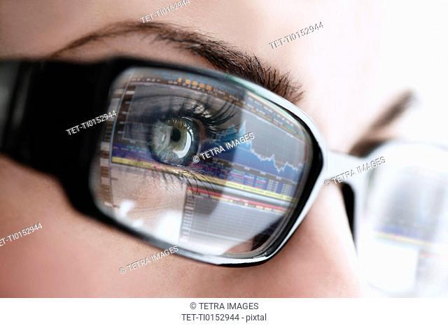 Studio close-up of woman wearing eyeglasses