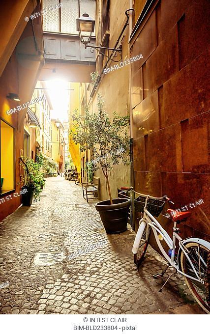 Bicycle in cobblestone alley, Bologna, Emilia-Romagna, Italy