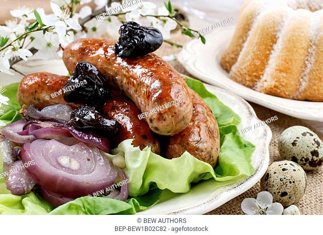 Sausage with plums and onion. Festive dish