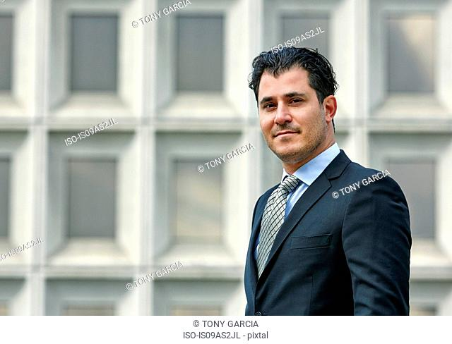 Portrait of mid adult business man looking at camera