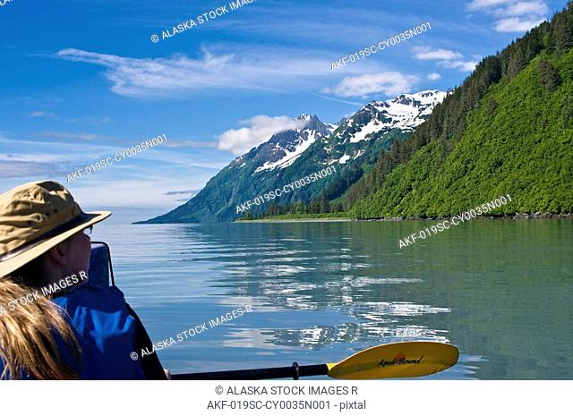 Woman kayaking in Port Valdez, Prince William Sound, Southcentral Alaska, Summer