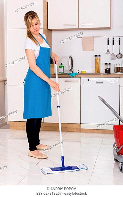 Cleaning Service Housekeeper Using Mop To Clean Kitchen Floor