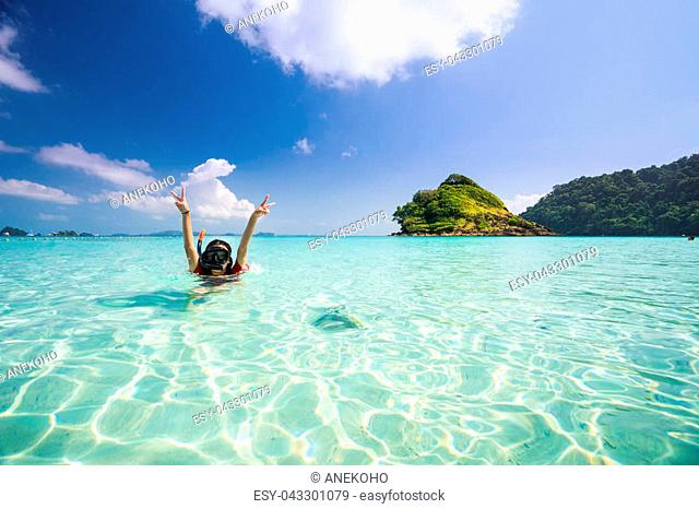 Asian girl swimming in Kam beach between Koh Kood and Koh Mak in Thailand sea, Island in Thailand and Asia, This immage can use for Summer
