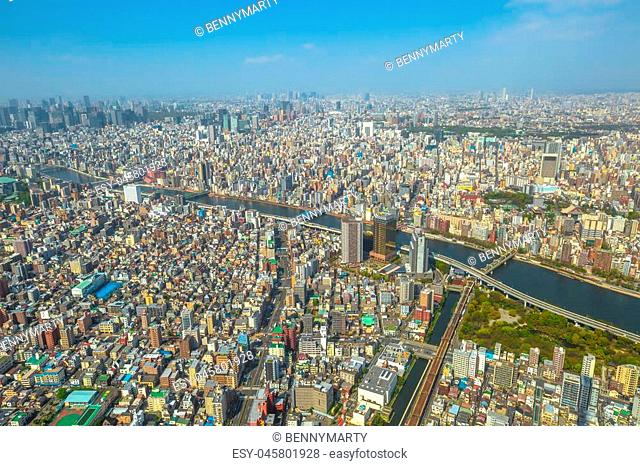 Aerial view of Tokyo city skyline with Asahi Beer Hall, Asahi Flame o Golden Turd, Sumida River Bridges and Asakusa area from Tokyo Skytree observatory