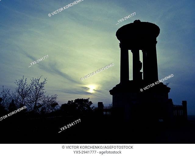 Silhouette view of Dugald Stewart Monument on Calton Hill in Edinburgh at sunset