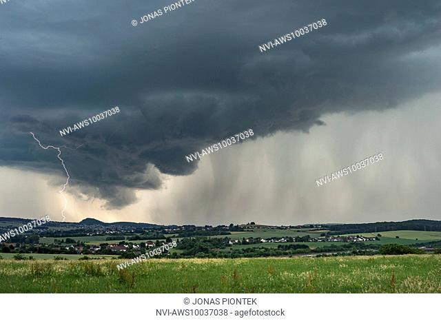 Cloud-to-ground lightning at wall cloud of a strong supercell near Saarlouis, Saarland, Germany
