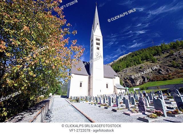 Zernez, its cemetery and the Saint Bastian Church, Lower Engadine, Switzerland Europe