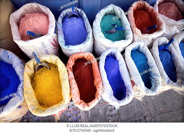 Sacks of dyes for dyeing lime and paint of different typical colors. Chaouen, Morocco