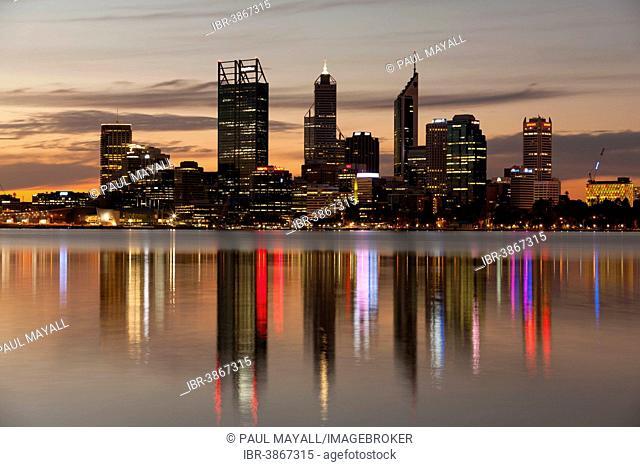 Skyline reflecting on the Swan River at dusk, Perth, Western Australia