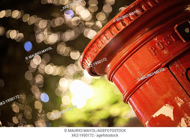 Close up of a red Royalmail postbox at Christmas, Manchester, UK