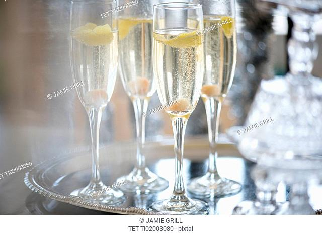 Champagne in champagne flutes on tray