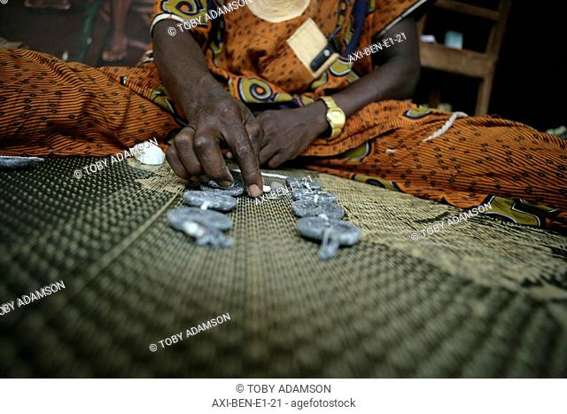 Porto Novo, Benin, West Africa. A Bokonon, or diviner, consults Fa, a traditional method of divining / geomancy