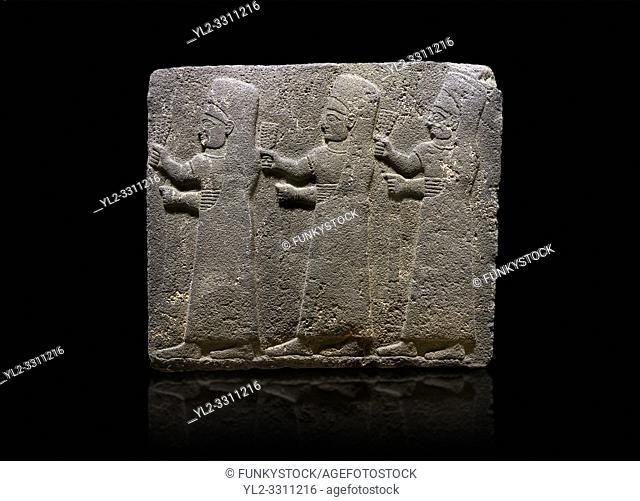 Hittite monumental relief sculpted orthostat stone panel of a Procession Basalt, Kargamis, Gaziantepe, 900 - 700 B. C. Anatolian Civilisations Museum, Ankara