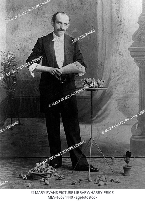 A 19th century substantially moustached magician named Powell, holding a rose Bouquet
