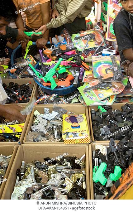 Toy guns in shop during Diwali deepawali festival , India