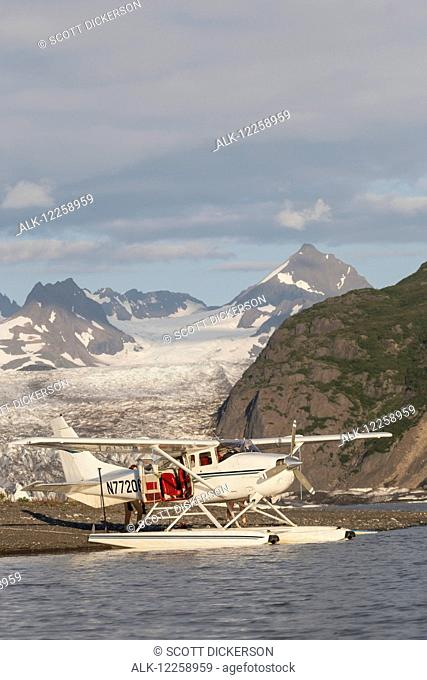 Float plane moored on the beach in front of Grewingk Glacier, Kachemak Bay State Park, Kenai Peninsula, Southcentral Alaska