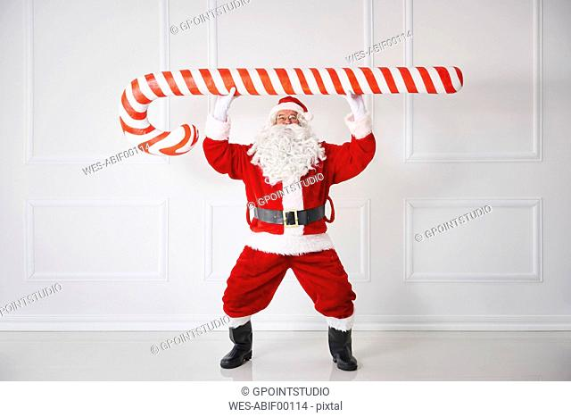 Santa Claus with oversized candy cane