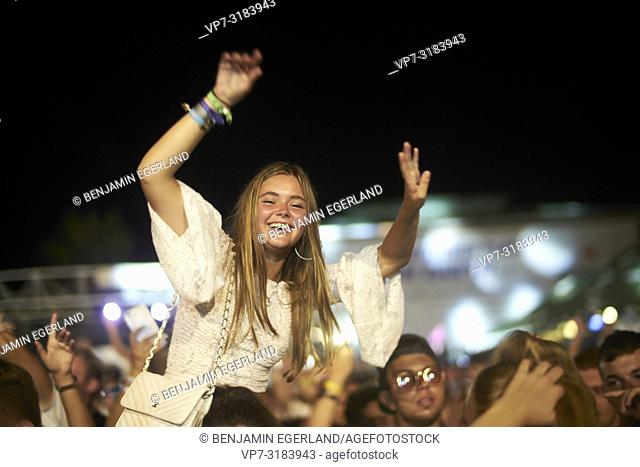 woman enjoying Party crowd at music festival Starbeach on 13. August 2018 in Chersonissos, Crete, Greece