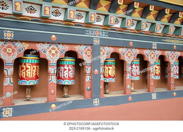 Prayer wheels and beautifully painted wall of a temple located near statue of Buddha Dordenma, Thimphu, Bhutan