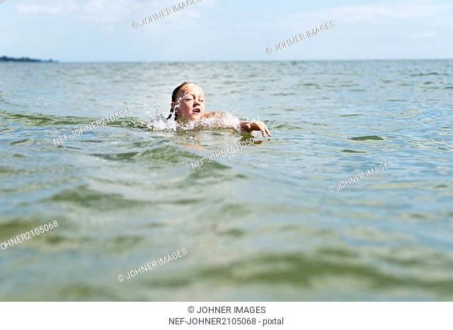 Girl swimming in sea