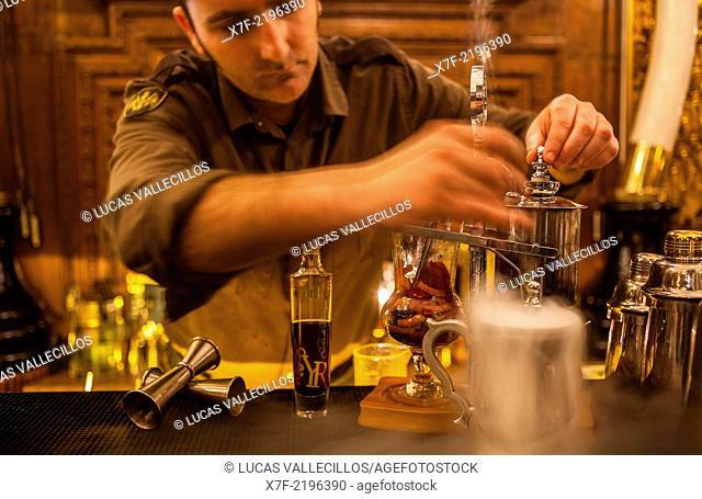 barman prepare coctail drink called Santo Grial, in Bocagrande restaurant / Boca chica Bar,Passatge de la Concepcio 12.Barcelona, Spain