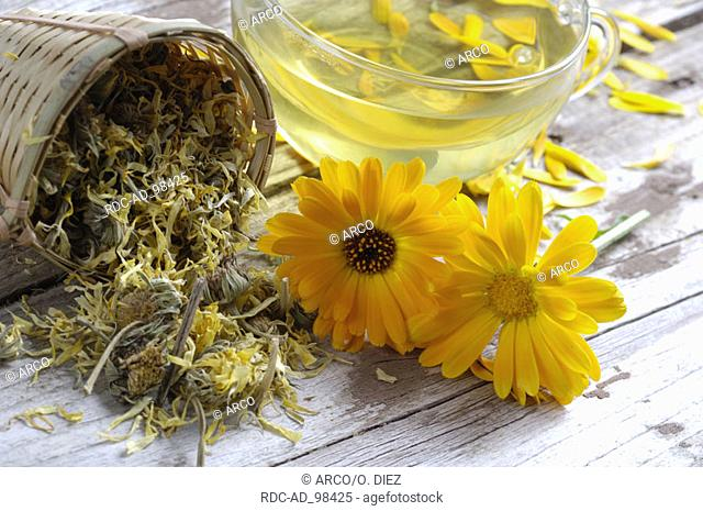 Garden Marigold dried and a cup of tea Calendula officinalis