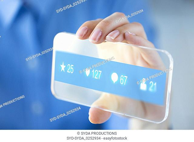 hand with social media icons on smartphone