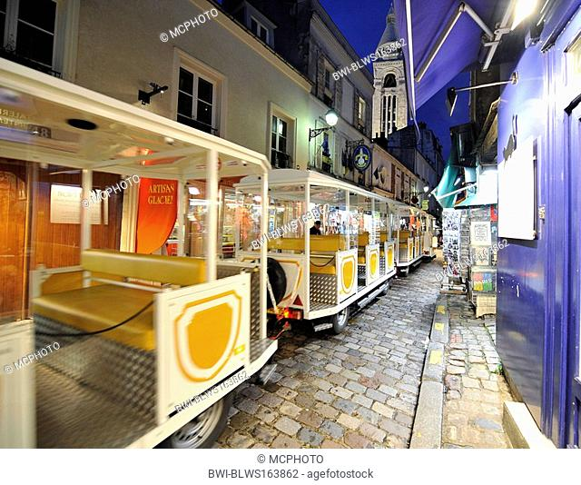 small train at Montmartre, Sacre Coeur in background, France, Paris