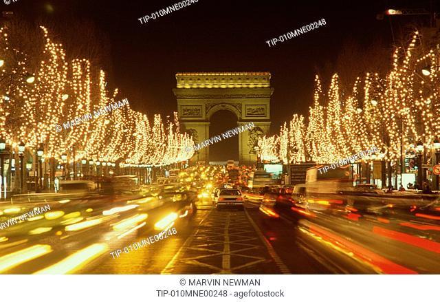 France, Paris. Christmas lights on Champs Elysèes and Arc de Triomphe