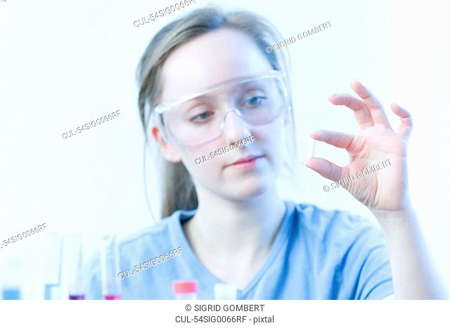 Scientist examining pill in lab