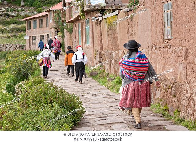 People of Taquile Island wearing traditional clothes, Lake Titicaca, Peru