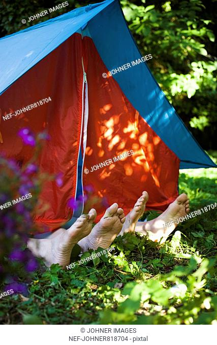 Feet sticking out of a tent, Sweden