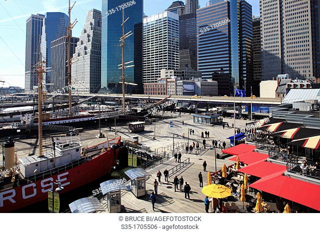 The view of South Street Seaport with the high-rise office towers of Financial District in the background  New York City  New York  USA
