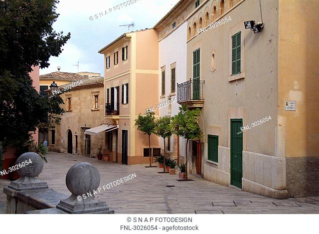 Buildings along an alley in the old town of Alcudia, Majorca, Spain