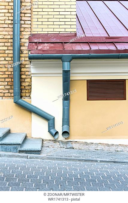 Old house with gutter and downspout