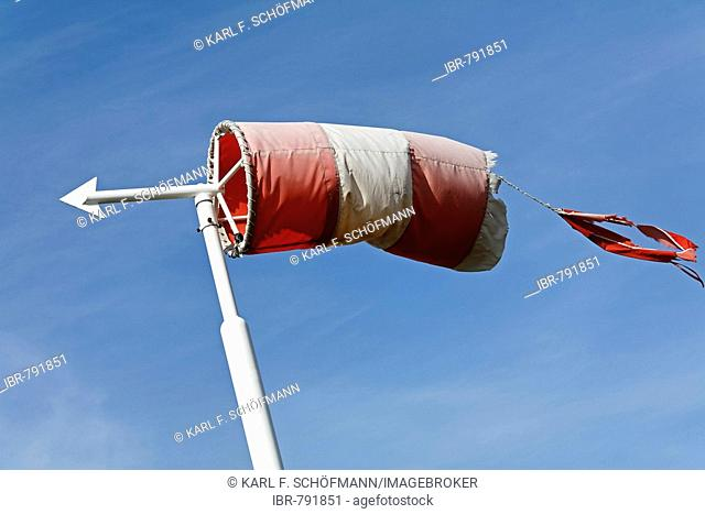 Shredded windsock and directional arrow, strong wind