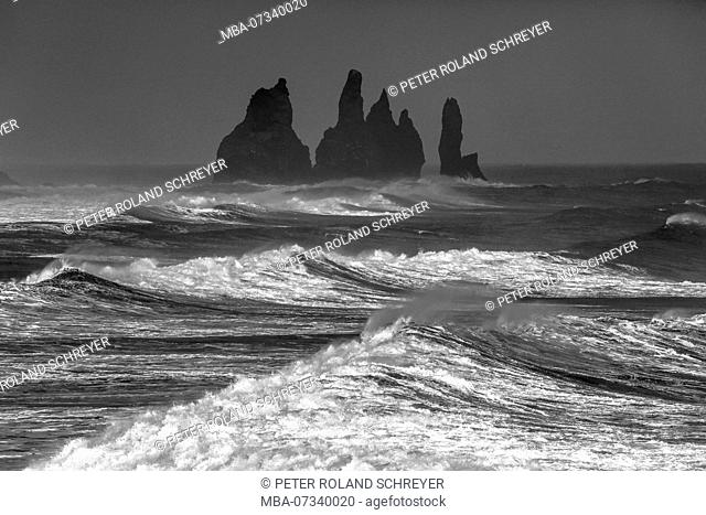 Reynisdrangar, black cliffs at Vik in stormy sea, white waves