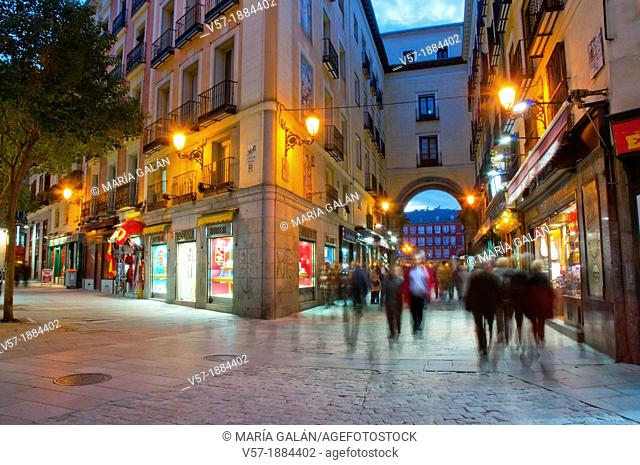 Spain, Madrid, People walking on Postas street at dusk