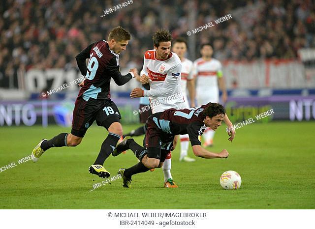 Duel for the ball, from left, Rurik Gislason, FC Copenhagen, Thomas Delaney, FC Copenhagen, below, and Martin Harnik, VfB Stuttgart, Mercedes-Benz Arena